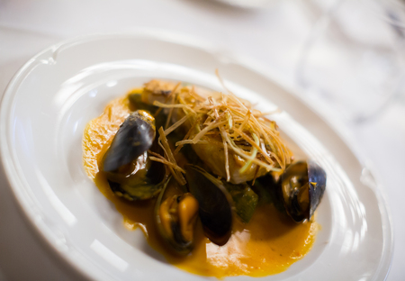 grilled fish with mussels and sauce, close up, local focus Stock Photo