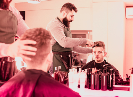 scandalous: Young spanish client feeling discontent about his new haircut at hair salon