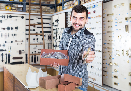 positive european male seller sorting boxes with door handles in houseware shop Stock Photo - 78949595  sc 1 st  123RF.com & Positive European Male Seller Sorting Boxes With Door Handles ...