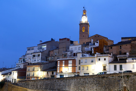 Ancient residential quarter and church with evening lights in Albaida Stock Photo