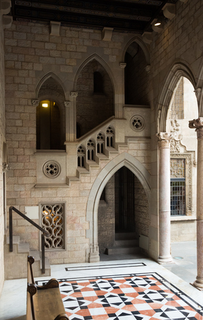 Gothic gallery and inner courtyard in palace Generalitat de Catalunya dated  15th century. Barcelona, Spain Editorial