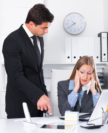 tardiness: Angry boss blowing up female subordinate for being late
