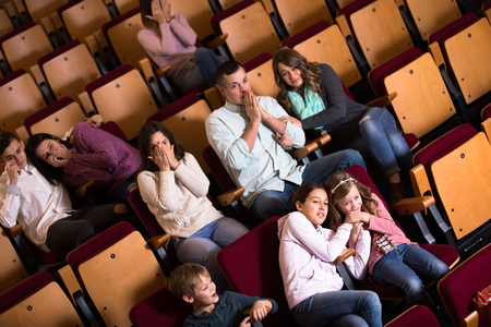 adrenaline rush: Group people watching movie night for horror in cinema