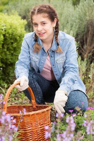 positive young english female with shovel working in the outdoor Stock Photo