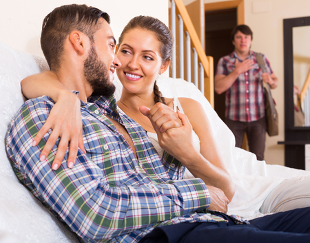Cheating partner coming home in wrong moment Stock Photo
