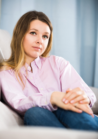 friendless: Young female feeling and spending day alone at home Stock Photo