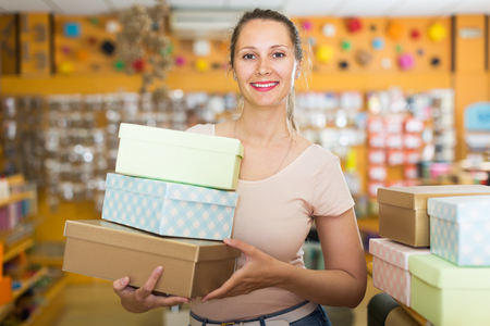 Young  woman holds in her hands gift boxes Stock Photo