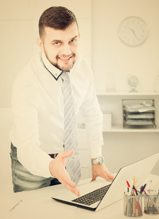inventiveness: Young male manager ready to receive clients in his office Stock Photo