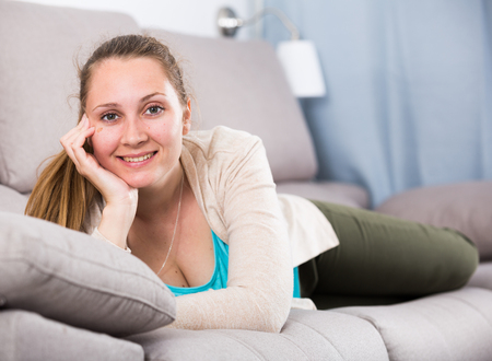 Smiling girl using various poses having good time in leisure time