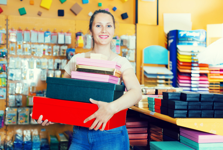pasteboard: girl brags about buying boxes for gifts and souvenirs in the store