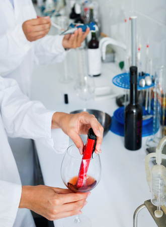View on hands working in chemical laboratory checking wine qualities