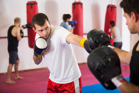 Portrait of young sportsmen competing in boxing gloves