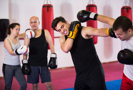 pugilist: Two athlete men in sportswear training boxing sparring at box class