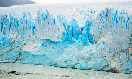 Rugged glacier cracked edge Perito Moreno (Glaciar Perito Moreno) on sunny summer day. Patagonia, Argentina, Andes