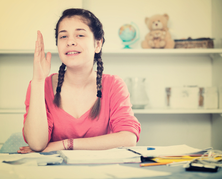 productive: Young female student studying productively alone at home Stock Photo