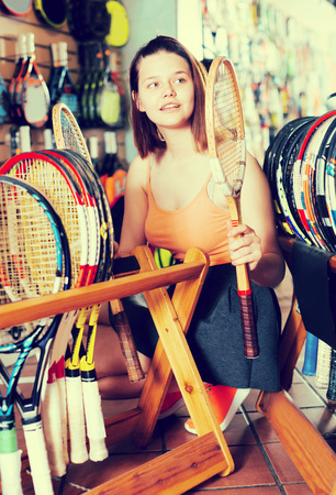 happines: teenager select a new racket for badminton in the sports shop Stock Photo