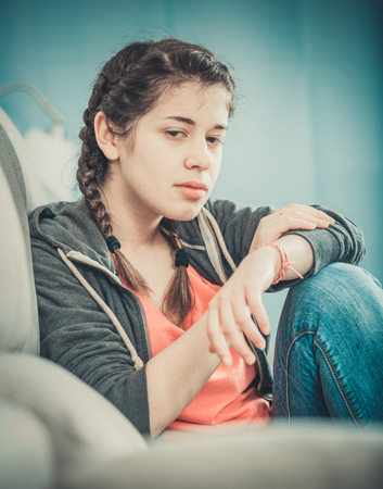 friendless: Sad young female teenager spending day alone at home
