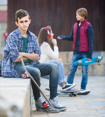 16s: Jealous teen and his young friends after conflict outdoors Stock Photo
