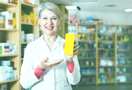 Ordinary woman recommending skin care products in specialized shop