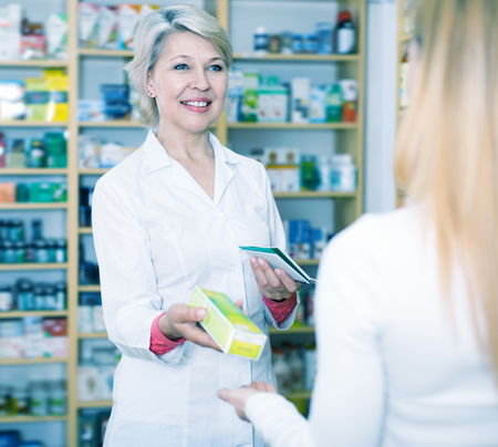 trustworthy: Adult seller recommending care products to customer in specialized shop