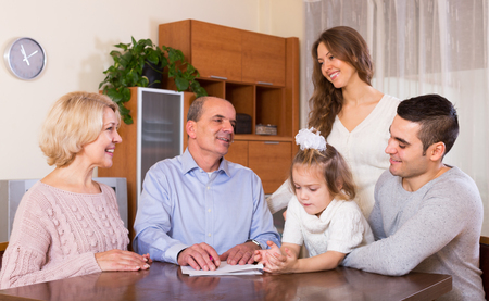 granny and grandad: Big family making shopping list together at apartment