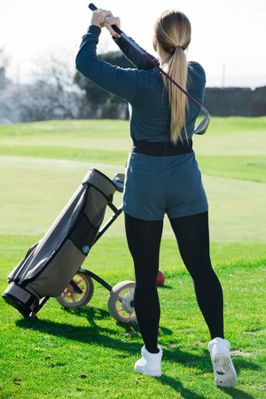 Woman 25-29 years old looks successfully after the golf game outdoors.