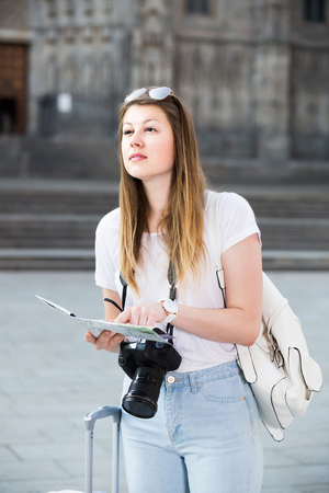 northern european: young happy spanish woman having  map and looking for her route in the city Stock Photo