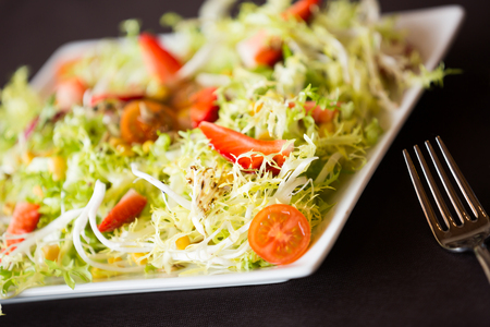green salad with crunchy lettuce and sweet strawberries is nicely served