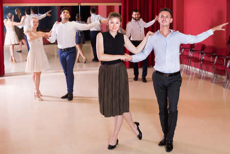 25s: Positive people practicing passionate samba in dance class Stock Photo