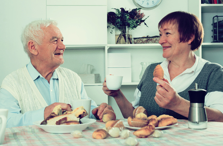 entertaining: Aged husband and wife enjoying quiet evening together at home Stock Photo