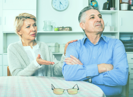 Elderly ordinary mature couple decide family matters and find out relationship in his house