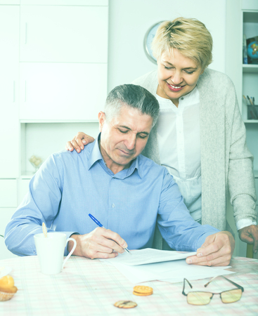queries: Wife and husband are lead discussion about agreement of the credit. Stock Photo