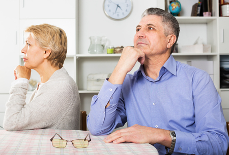 Aged couple quarrels with each other at clarification of the family relation