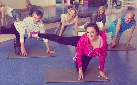 lifestile: Group of active adults doing pilates routine in a sport club
