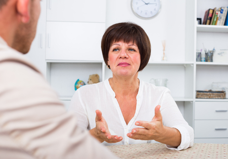 Employer discusses with future worker of employment condition