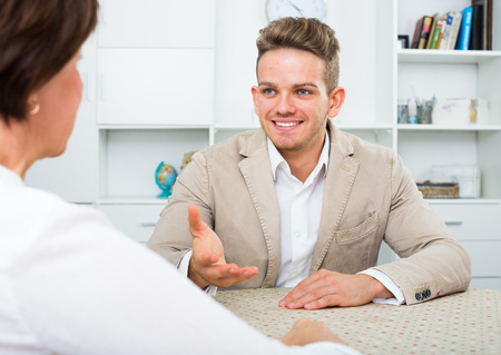 Young active manager suggests elderly lady to make two-way deal