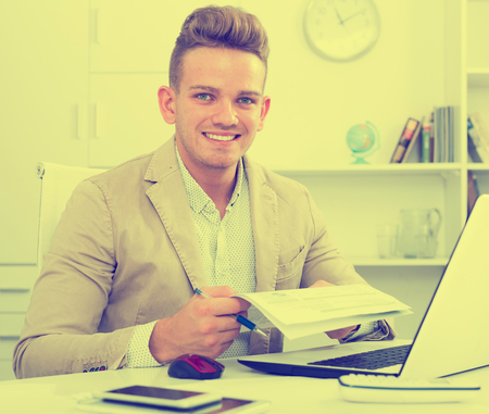 25s: Portrait of successful businessman working in modern office Stock Photo