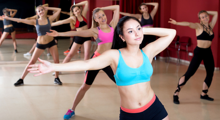 choreographic: Attractive young women learn the movements for a new dance in a choreographic studio