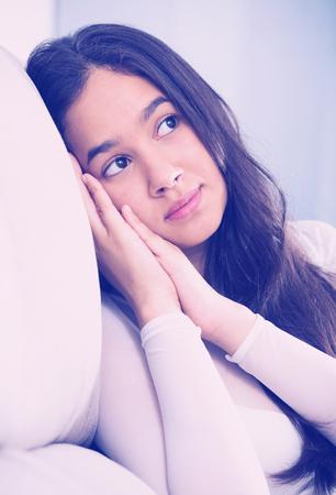 Gloomy teenager girl depression at home on comfortable sofa Stock Photo