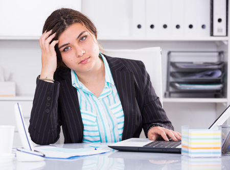 expertize: Young woman is having complicated issue with project in office.