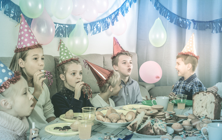 animate: Glad cheerful positive boys and girls happy to see each other during Christmas dinner