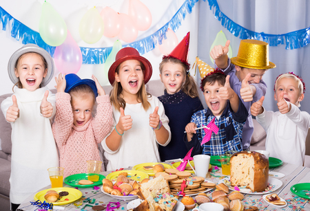animate: Smiling children happy to celebrate friend's birthday during dinner