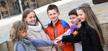Friendship forever - portrait of cheerful junior school kids outdoor