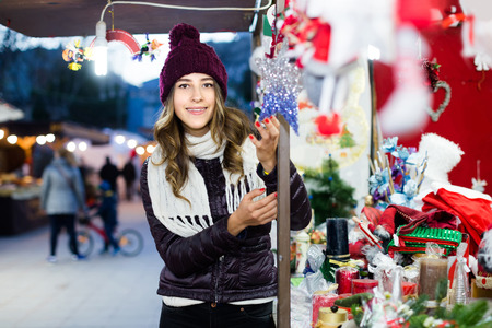 Portrait of young smiling russian woman at Christmas fair