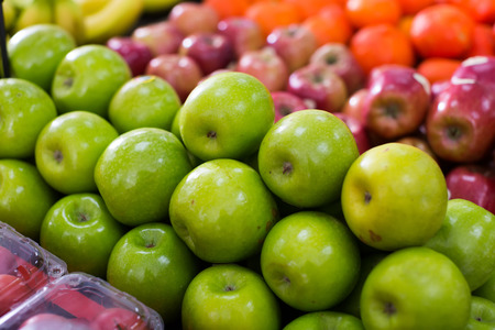 closeup view on green and red apples on the market