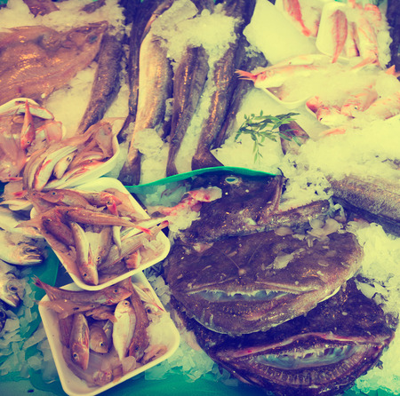 phosphorus: fish on counter of seafood market in spain