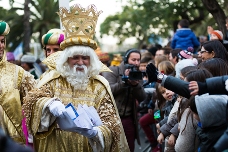 melchor: BARCELONA, SPAIN –  JANUARY 5, 2017: Three of King with entourage take letters from children. Barcelona, Spain