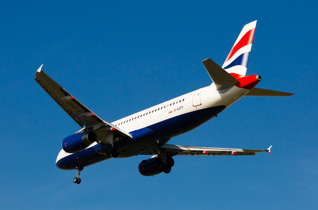 BARCELONA, SPAIN - MARCH 09, 2017:  British Airlines plane landing in El Prat Airport on time. Barcelona, Spain