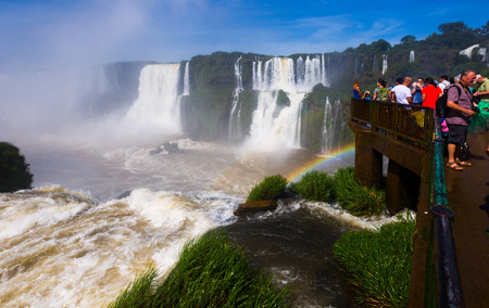 noteworthy: IGUAZU NATIONAL PARK, PARANA, BRAZIL - FEBRUARY 17, 2017: Observation deck and bridges for tourists on сomplex of waterfalls (Cataratas del Iguazu) on Iguazu River on border of Brazil and Argentina