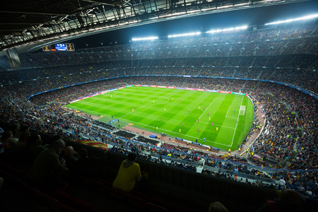 BARCELONA, SPAIN - NOVEMBER 04, 2015: Above view at field and audience during football game between FC Barcelona and FC BATE Borisov (Belarusian) on Nou Camp stadium. Banco de Imagens - 81678458